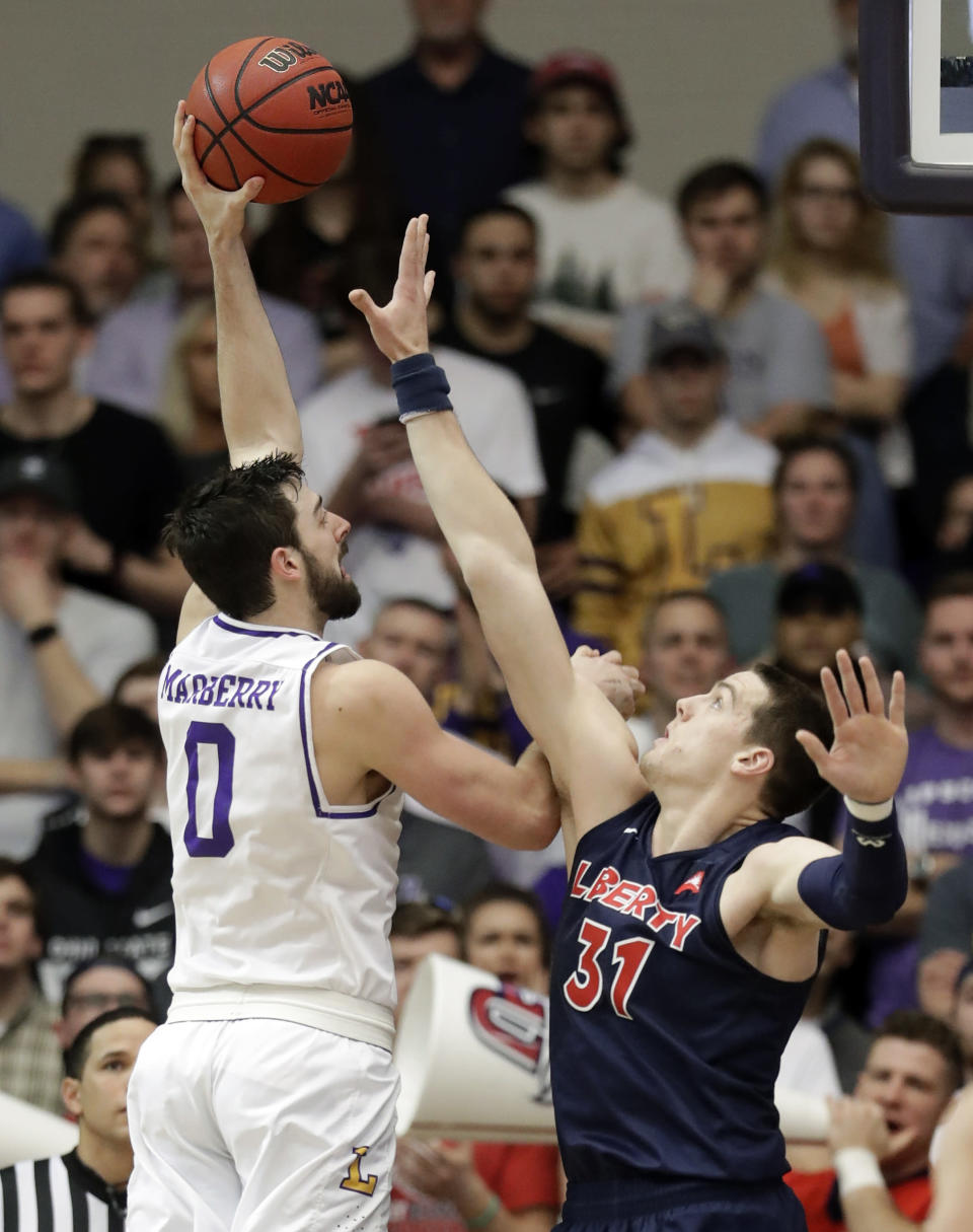 Lipscomb forward Rob Marberry (0) shoots against Liberty forward Scottie James (31) in the first half of the Atlantic Sun NCAA college basketball tournament championship game Sunday, March 10, 2019, in Nashville, Tenn. (AP Photo/Mark Humphrey)