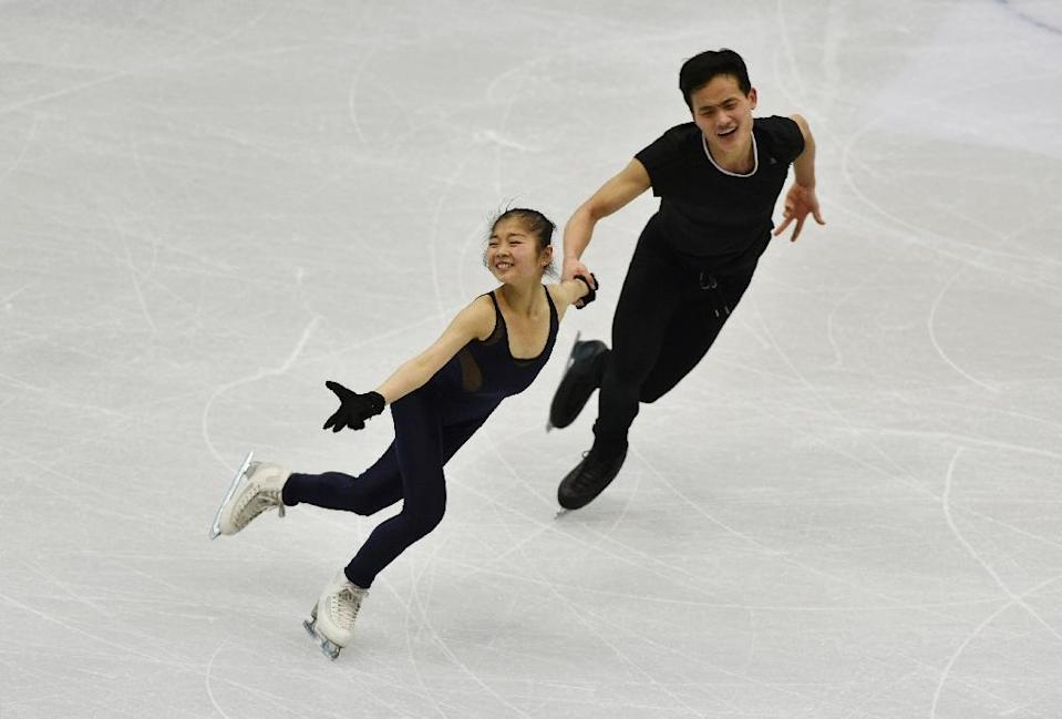 Ryom Tae-Ok (L) and Kim Ju-Sik (R) of North Korea attend a practice session in Taipei (AFP Photo/Mandy CHENG)