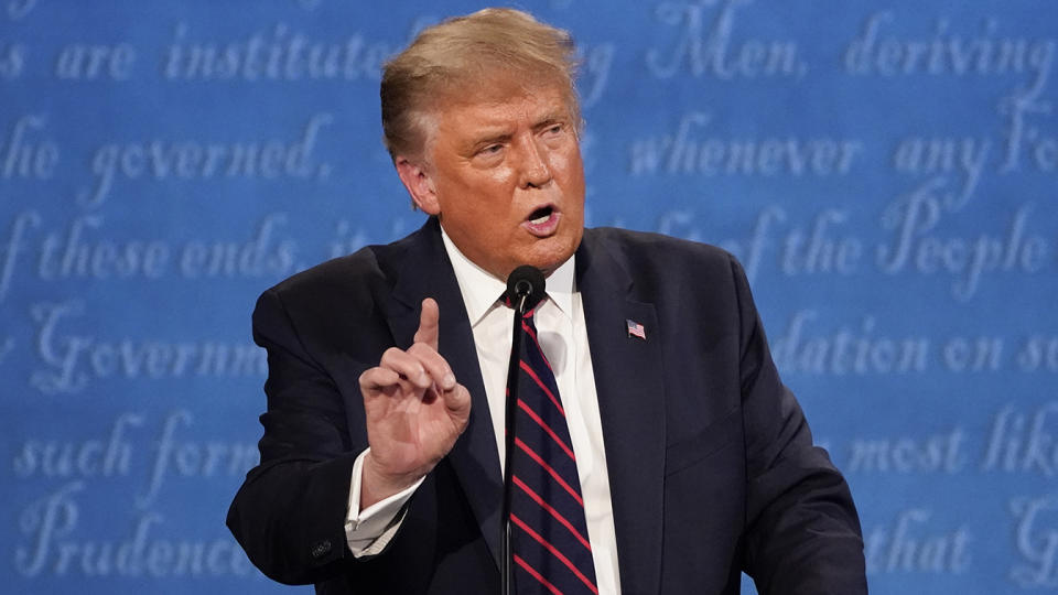 President Donald Trump gestures while speaking during the first presidential debate on Sept. 29, 2020, at Case Western University and Cleveland Clinic, in Cleveland, Ohio. (Julio Cortez/AP)