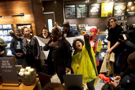 Protestors demonstrate inside a Center City Starbucks, where two black men were arrested, in Philadelphia, Pennsylvania, U.S., April 16, 2018.  REUTERS/Mark Makela