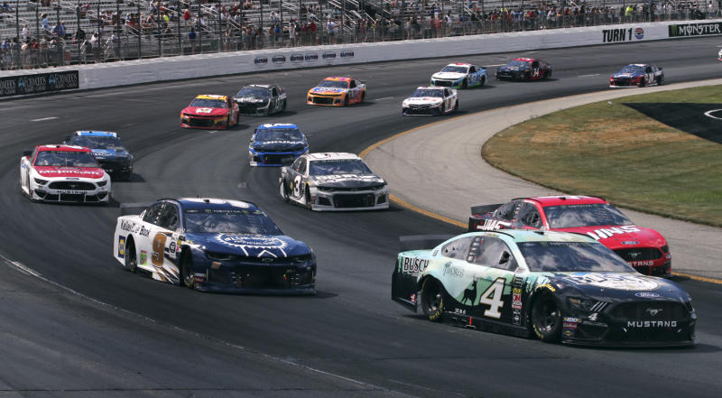 Kevin Harvick (4) heads through Turn 1 during a NASCAR Cup Series auto race at New Hampshire Motor Speedway in Loudon, N.H., Sunday, July 21, 2019. Harvick won the race. (AP Photo/Charles Krupa)