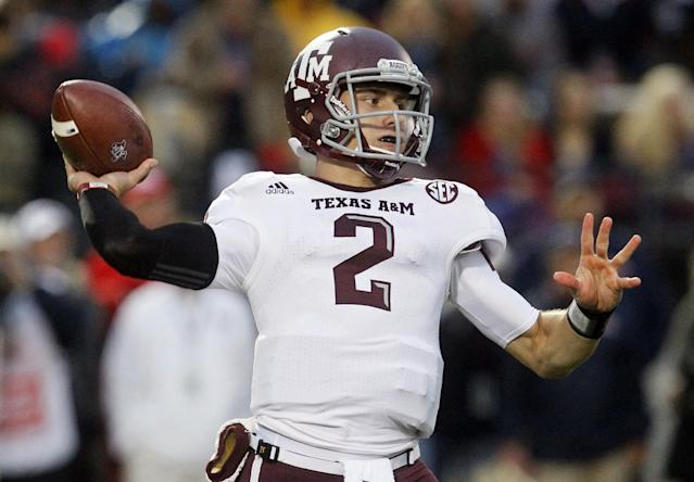 FILE - In this Oct. 6, 2012, file photo, Texas A&M quarterback Johnny Manziel throws a short pass in the first quarter of an NCAA college football game against Mississippi in Oxford, Miss. A record 98 underclassmen, including Manziel, have made themselves eligible for the NFL draft in May. (AP Photo/Rogelio V. Solis, File)