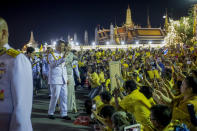 King Maha Vajiralongkorn and Queen Suthida wave to supporters in Bangkok, Thailand, Sunday, Nov. 1, 2020. Under increasing pressure from protesters demanding reforms to the monarchy, Thailand's king and queen met Sunday with thousands of adoring supporters in Bangkok, mixing with citizens in the street after attending a religious ceremony inside the Grand Palace. (AP Photo/Wason Wanichakorn)
