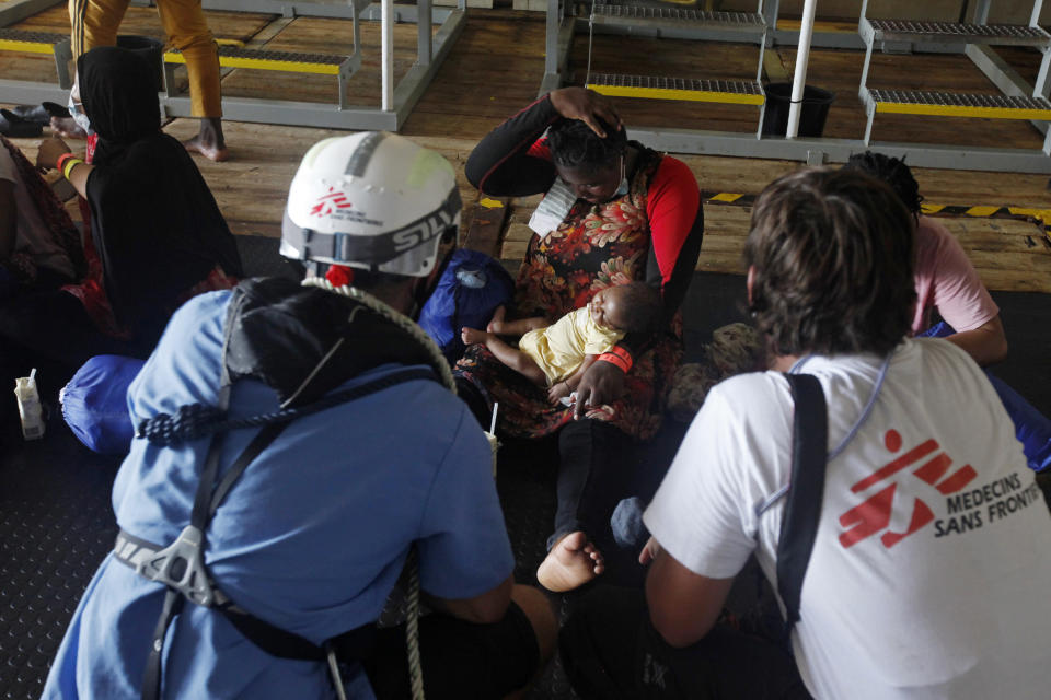 MV Geo Barents vessel of MSF (Doctors Without Borders) workers comfort a woman and child who were rescued from the Mediterranean Sea, off Libya, in the central Mediterranean route, Monday, Sept. 20, 2021 (AP Photo/Samy Magdy)