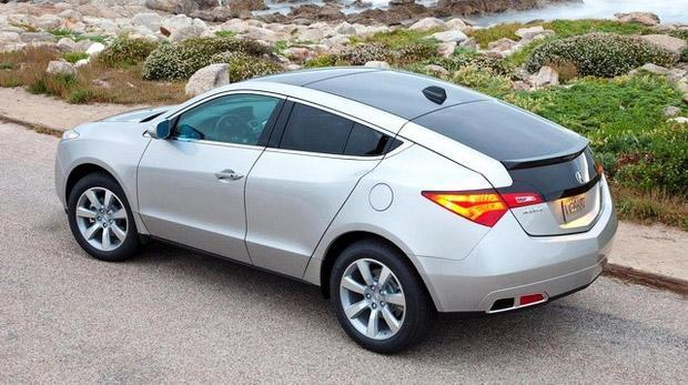 """<b>Worst Luxury Crossover - <a href=""""http://autos.yahoo.com/acura/zdx/"""" data-ylk=""""slk:2013 Acura ZDX"""" class=""""link rapid-noclick-resp"""">2013 Acura ZDX</a></b>: Sharing roughly the same footprint and weight as Acura's MDX, the ZDX features an aggressively raked roof that creates a far sleeker vehicle. Fair enough, as people are often willing to sacrifice some practicality to make a fashion statement, but probably not this much. That slashed roof yields a backseat that's friendly only for those who lack heads, while the chopped rear door openings may be the reason they lost them in the first place. The cargo area is meager for a vehicle its size and its 4,438-pound curb weight doesn't do the 300-horsepower V6 any favors. The ZDX is a full second slower from zero to 60 mph than the similarly shaped <a href=""""http://autos.yahoo.com/bmw/x6/"""" data-ylk=""""slk:BMW X6"""" class=""""link rapid-noclick-resp"""">BMW X6</a>.<br><br>Now, BMW's own coupe-crossover Frankenstein creation is hardly a bastion of buying sensibility, but unlike the ZDX, the BMW roundel is at least more likely to create that desired fashion statement than Acura's pinched A. Be it for fashion or transportation, we can't fathom why anyone would buy one."""