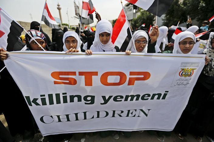 Girls demonstrate against the Saudi-led coalition outside the offices of the United Nations in Yemen's capital, Sanaa, in August 2015.
