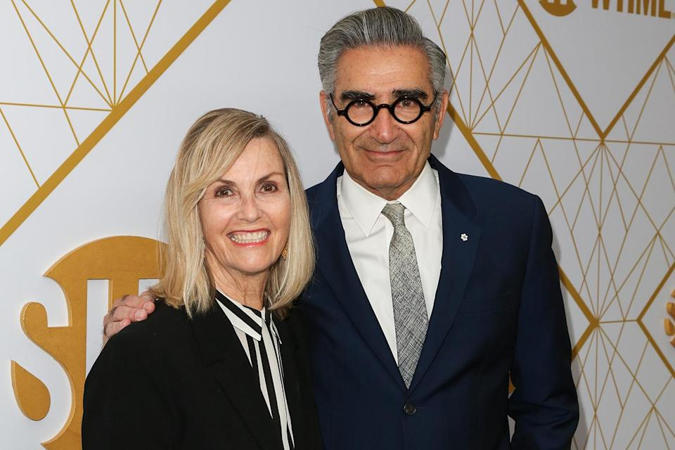 """<p>Just like his and Catherine O'Hara's characters' interfaith celebration on <em>Schitt's Creek</em>, Levy (who is Jewish) and his wife (who is Christian) also celebrate both holidays in real life. His son and costar, Dan, joked about the duality on <a href=""""https://twitter.com/danjlevy/status/277599374069080064"""" rel=""""nofollow noopener"""" target=""""_blank"""" data-ylk=""""slk:Twitter"""" class=""""link rapid-noclick-resp"""">Twitter</a> in 2012, writing, """"One half of me is celebrating Hanukkah, the other half is decorating a tree. My body is confused.<a href=""""https://twitter.com/hashtag/halfie?src=hashtag_click"""" rel=""""nofollow noopener"""" target=""""_blank"""" data-ylk=""""slk:#halfie"""" class=""""link rapid-noclick-resp""""> #halfie</a><a href=""""https://twitter.com/hashtag/chrismukkah?src=hashtag_click"""" rel=""""nofollow noopener"""" target=""""_blank"""" data-ylk=""""slk:#chrismukkah.&quot;"""" class=""""link rapid-noclick-resp""""> #chrismukkah.""""</a></p>"""