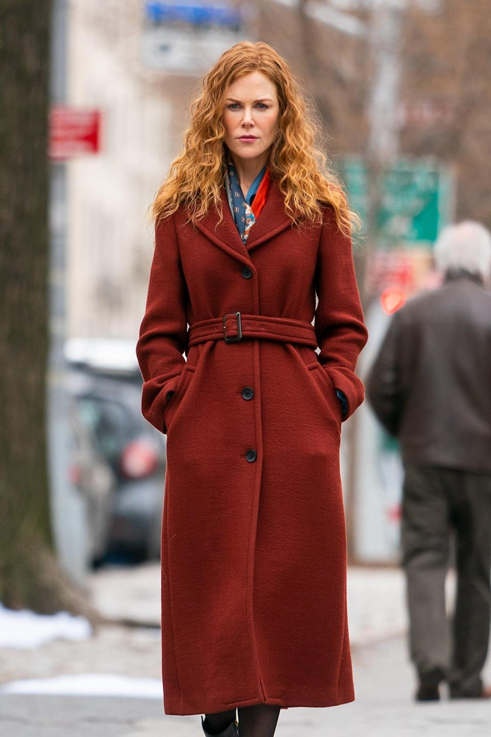 <p>This tailored burgundy number is a 3.1 Phillip Lim design that features four large buttons, pockets, and a belt. Don't get your hopes up too much for copying this look, though, because <span>it's unfortunately sold out</span>.</p>