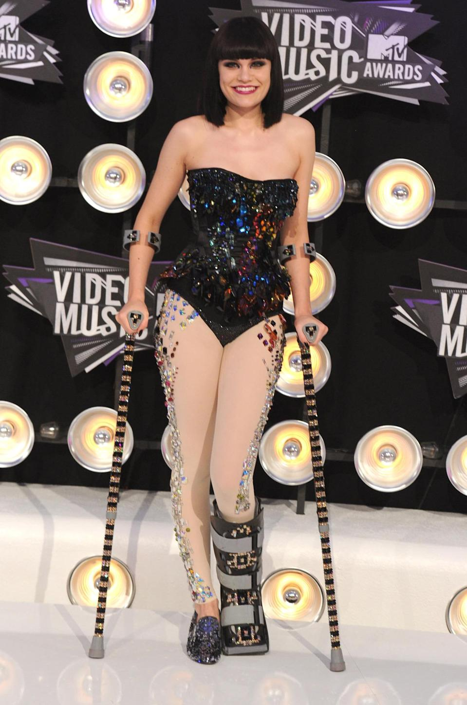 <p>The singer hit the 2011 VMAs in a boot and crutches, which she tricked out with a generous helping of rhinestones. <i>(Photo: Getty)</i></p>