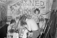 <p>AC/DC celebrates after a successful performance at the Marquee Club in London in 1976. </p>