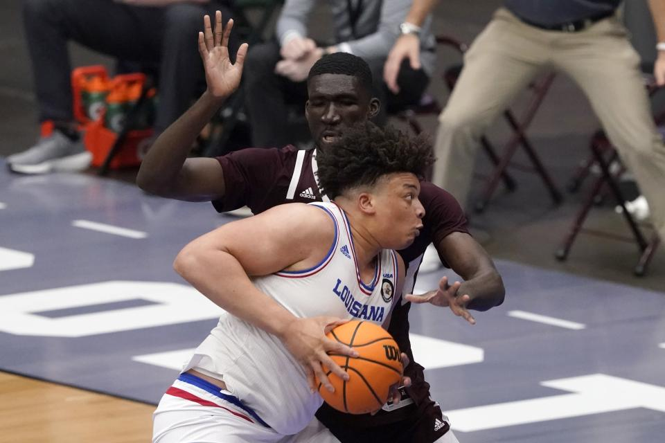 Louisiana Tech forward Kenneth Lofton Jr. (2) works against Mississippi State forward Abdul Ado, rear, for a shot opportunity in the first half of an NCAA college basketball game in the semifinals of the NIT, Saturday, March 27, 2021, in Frisco, Texas. (AP Photo/Tony Gutierrez)