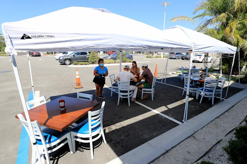 Diners outside Cruisers Grill in Jacksonville Beach as Florida entered phase one of the plan to reopen the state.