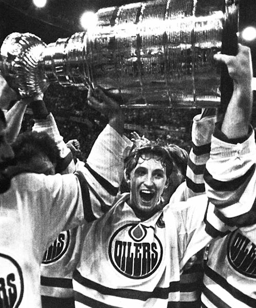 FILE - In this May 19, 1984, file photo, Wayne Gretzky and the Edmonton Oilers carry off the Stanley Cup in Edmonton, after they defeatd the New York Islanders. The NHL has the best names in the business. Nicknames, that is. Little Ball of Hate. The Great One (Gretzky). Tazer. Bicksy. (AP Photo/Larry MacDougall, File)