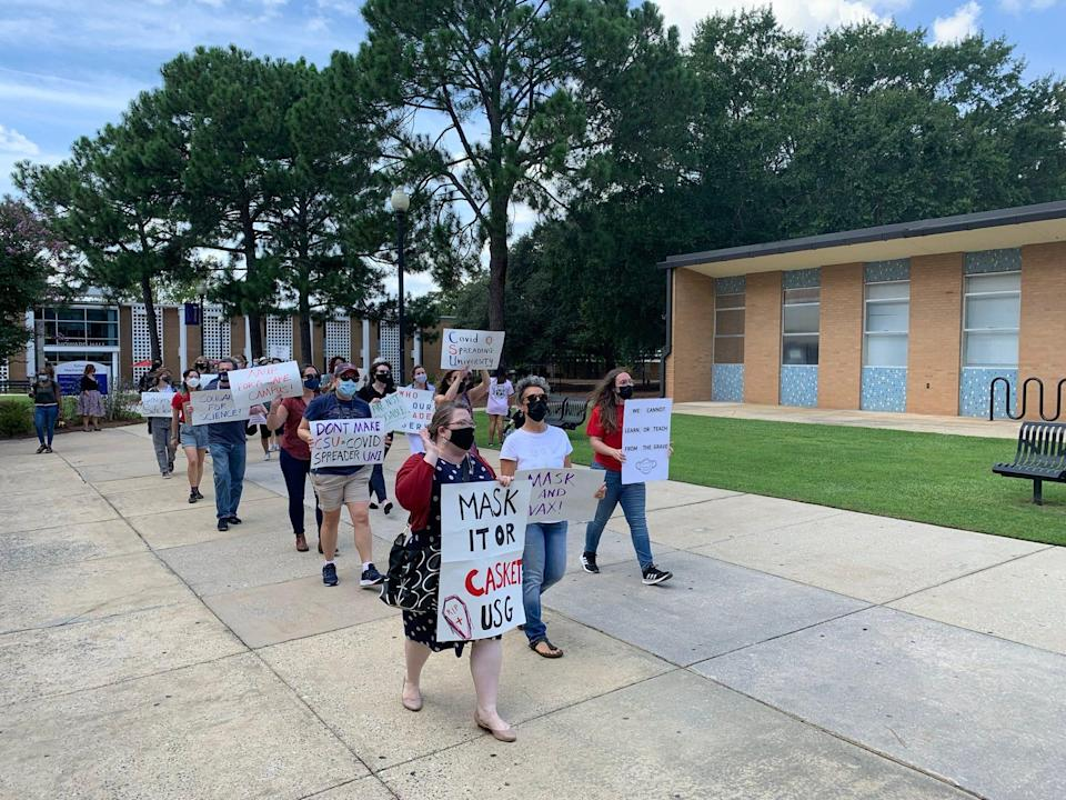 Faculty and students from Columbus State in Columbus, Georgia, protest the lack of mask and vaccine mandates on their campus.