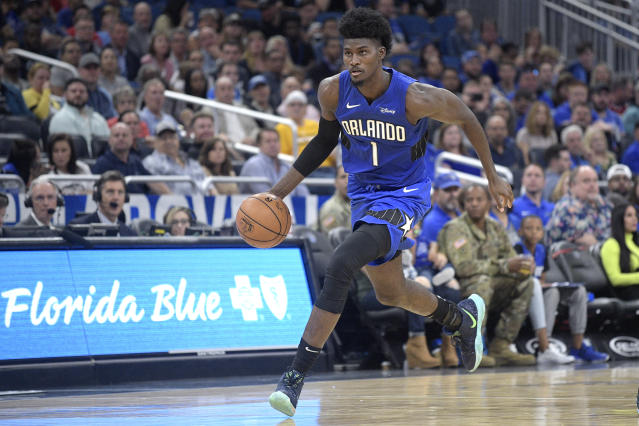 Jonathan Isaac missed Orlando's game against the Spurs on Friday night after he apparently rolled his ankle during a jersey unveiling ceremony. (AP/Phelan M. Ebenhack)