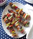 """<p>Smoked sausages and a rainbow of grilled veggies make for the ultimate backyard barbecue fare. Bonus: You can prep and stack these kabobs ahead of time.</p><p><a href=""""https://www.goodhousekeeping.com/food-recipes/a10147/sausage-pepper-kabobs-recipe-ghk0710/"""" rel=""""nofollow noopener"""" target=""""_blank"""" data-ylk=""""slk:Get the recipe for Sausage-Pepper Kabobs »"""" class=""""link rapid-noclick-resp""""><em>Get the recipe for Sausage-Pepper Kabobs »</em></a></p>"""