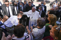 Pope Francis blesses an unidentified man as he greets the crowd while leaving the Cathedral of Saint Martin, in Bratislava, Slovakia, Monday, Sept. 13, 2021. Francis is on a four-day visit to Central Europe, in Hungary and Slovakia, in his first big international outing since undergoing intestinal surgery in July. (AP Photo/Petr David Josek)