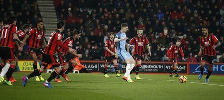 Britain Football Soccer - AFC Bournemouth v Manchester City - Premier League - Vitality Stadium - 13/2/17 Manchester City's John Stones in action with Bournemouth's Jack Wilshere and teammates Reuters / Peter Nicholls Livepic