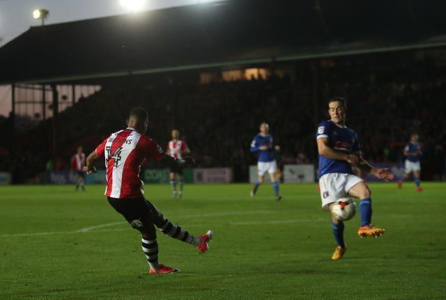 Ollie Watkins, left, scores for Exeter against Carlisle in 2017