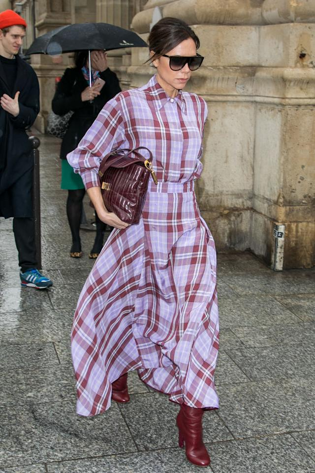 <p>On March 8, the designer was photographed in Paris donning a seriously covetable plaid dress and burgundy accessories. <em>[Photo: Getty]</em> </p>