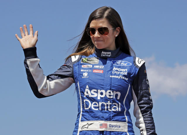 FILE – In this July 16, 2017, file photo, driver Danica Patrick waves prior to the NASCAR Cup Series auto race at the New Hampshire Motor Speedway in Loudon, N.H. Patrick announced plans Friday, Nov. 17, 2017, to run just 2 races in 2018, the Daytona 500 and the Indianapolis 500, and end her full-time driving career. (AP Photo/Charles Krupa, File)