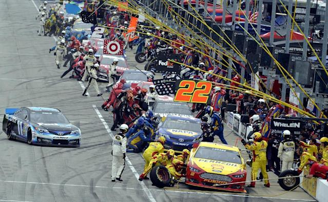 Drivers make a pit stop during the NASCAR Sprint Cup series auto race at Chicagoland Speedway, Sunday, Sept. 15, 2013, in Joliet, Ill. (AP Photo/Warren Wimmer)