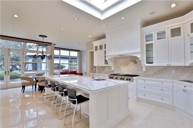 The Crema Marfil marble tile floor in the kitchen is heated.