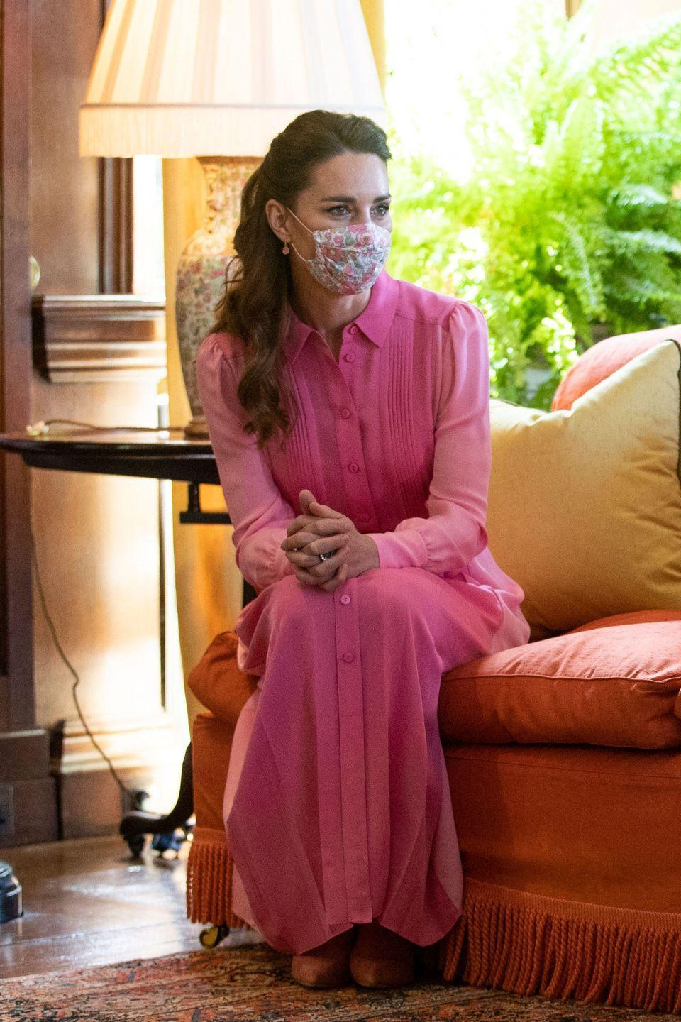 """<p>The Duchess met five year-old Mila Sneddon, a cancer patient who was featured in Kate's <em><a href=""""https://www.townandcountrymag.com/society/tradition/a35960777/kate-middleton-hold-still-covid-photography-book/"""" rel=""""nofollow noopener"""" target=""""_blank"""" data-ylk=""""slk:Hold Still"""" class=""""link rapid-noclick-resp"""">Hold Still </a></em><a href=""""https://www.townandcountrymag.com/society/tradition/a35960777/kate-middleton-hold-still-covid-photography-book/"""" rel=""""nofollow noopener"""" target=""""_blank"""" data-ylk=""""slk:photography book"""" class=""""link rapid-noclick-resp"""">photography book</a>. <a href=""""https://twitter.com/KensingtonRoyal/status/1397935506621669376"""" rel=""""nofollow noopener"""" target=""""_blank"""" data-ylk=""""slk:When the pair spoke on the phone"""" class=""""link rapid-noclick-resp"""">When the pair spoke on the phone</a>, Kate told Mila that when they met, she would dress like """"a princess"""" and wear pink. The Duchess kept that promise, arriving to their meeting in this bubblegum ME+EM dress. </p><p><a class=""""link rapid-noclick-resp"""" href=""""https://go.redirectingat.com?id=74968X1596630&url=https%3A%2F%2Fwww.meandem.com%2Fus%2Fcolour-block-silk-shirt-dress-and-belt-sugar-pink-bubblegum&sref=https%3A%2F%2Fwww.townandcountrymag.com%2Fstyle%2Ffashion-trends%2Fnews%2Fg1633%2Fkate-middleton-fashion%2F"""" rel=""""nofollow noopener"""" target=""""_blank"""" data-ylk=""""slk:Shop the Dress"""">Shop the Dress</a></p>"""