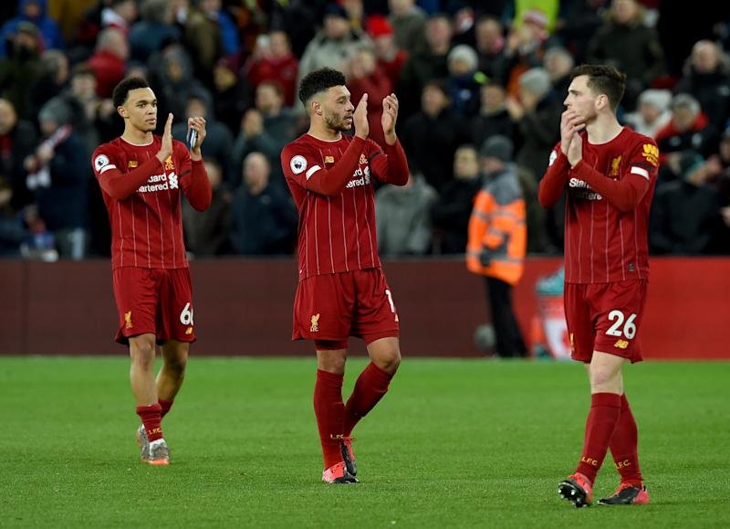 LIVERPOOL, ENGLAND - FEBRUARY 24: (THE SUN OUT, THE SUN ON SUNDAY OUT) Trent Alexander-Arnold, Alex Oxlade-Chamberlain and Andy Robertson of Liverpool showing their appreciation to the fans at the end of the Premier League match between Liverpool FC and West Ham United at Anfield on February 24, 2020 in Liverpool, United Kingdom. (Photo by John Powell/Liverpool FC via Getty Images)
