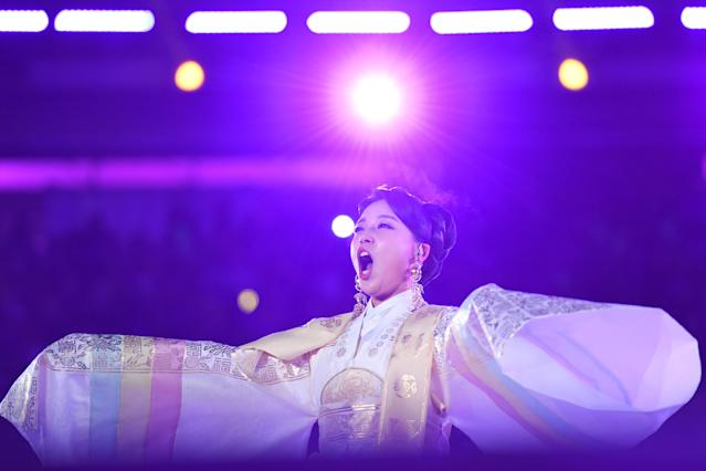 <p>South Korean singer Hwang Su-mi performs during the opening ceremony of the Pyeongchang 2018 Winter Olympic Games at the Pyeongchang Stadium on February 9, 2018. / AFP PHOTO / Kirill KUDRYAVTSEV </p>