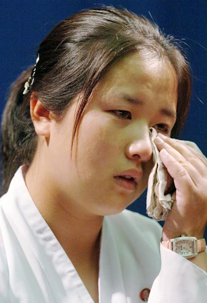 FILE - In this July 6, 2006 file photo, Kim Un Kyong, who's Japanese mother Megumi Yokota was adducted by North Korea in 1977, is moved to tears while speaking about her Japanese grandparents, Shigeru and Sakie Yokota, during a press conference at a hotel in Pyongyang, North Korea. Japan's Foreign Ministry confirmed Sunday, March 16, 2014, that Shigeru Yokota and his wife Sakie spent spent time with their Korean-born granddaughter Kim, for the first time over several days last week in Ulan Bator, Mongolia. Kim is 26 years old, Japanese media said. (AP Photo/Kyodo News, File) JAPAN OUT, MANDATORY CREDIT