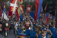 """Actors portraying knights from various historic periods march together with the Serbian army honor guards during a ceremony to mark the newly established """"Day of Serb Unity, Freedom and the National Flag"""" state holiday in Belgrade, Serbia, Wednesday, Sept. 15, 2021. Serbia has kicked off a new holiday celebrating national unity with a display of military power, triggering unease among its neighbors. (AP Photo/Marko Drobnjakovic)"""