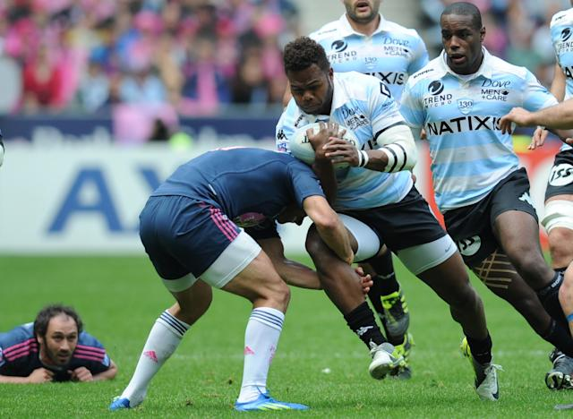 Racing Metro's Fijian flanker Jone Qovu (C) runs with the ball during the French Top 14 rugby union match Stade Francais vs. Racing Metro on May 5, 2012 at the Charlety stadium in Paris. AFP PHOTO / FRANCK FIFEFRANCK FIFE/AFP/GettyImages