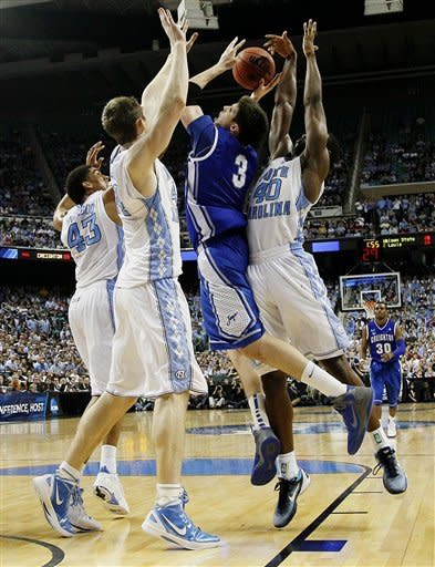 North Carolina's James Michael McAdoo (43), Tyler Zeller and Harrison Barnes (40) guard Creighton's Doug McDermott (3) during the second half of an NCAA tournament third-round college basketball game in Greensboro, N.C., Sunday, March 18, 2012. North Carolina won 87-73. (AP Photo/Gerry Broome)