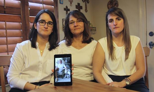 Dennysse Vadell sits between her daughters Veronica, right, and Cristina holding a digital photograph of father and husband Tomeu, who is currently jailed in Venezuela, in Katy, Texas. Tomeu Vadell is one of six executives from Houston-based Citgo who has spent 15 months jailed in Venezuela on what their families say are trumped-up corruption charges. (AP Photo/John L Mone, File, File)