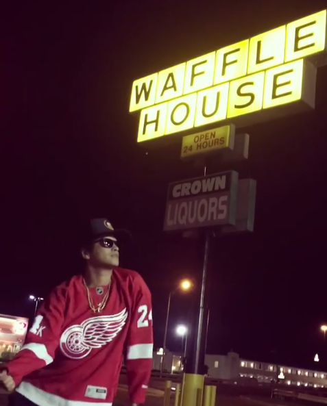 """<p>The """"Uptown Funk"""" singer chose a Waffle House — not a luxurious hotel or an exclusive nightclub — for the location of his <a rel=""""nofollow"""" href=""""https://www.instagram.com/p/BXw7AnKB3HK/"""">video release party</a> for the song """"Versace on the Floor."""" But, of course, he didn't just stand there. Mars busted a move, right there in the Indianapolis parking lot. (Photo: <a rel=""""nofollow"""" href=""""https://www.instagram.com/p/BXw7AnKB3HK/?taken-by=brunomars"""">Bruno Mars via Instagram</a>)<br /><br /></p>"""