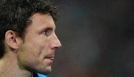 "Dutch skipper Mark van Bommel was quoted as saying ""We all heard the monkey chants"""