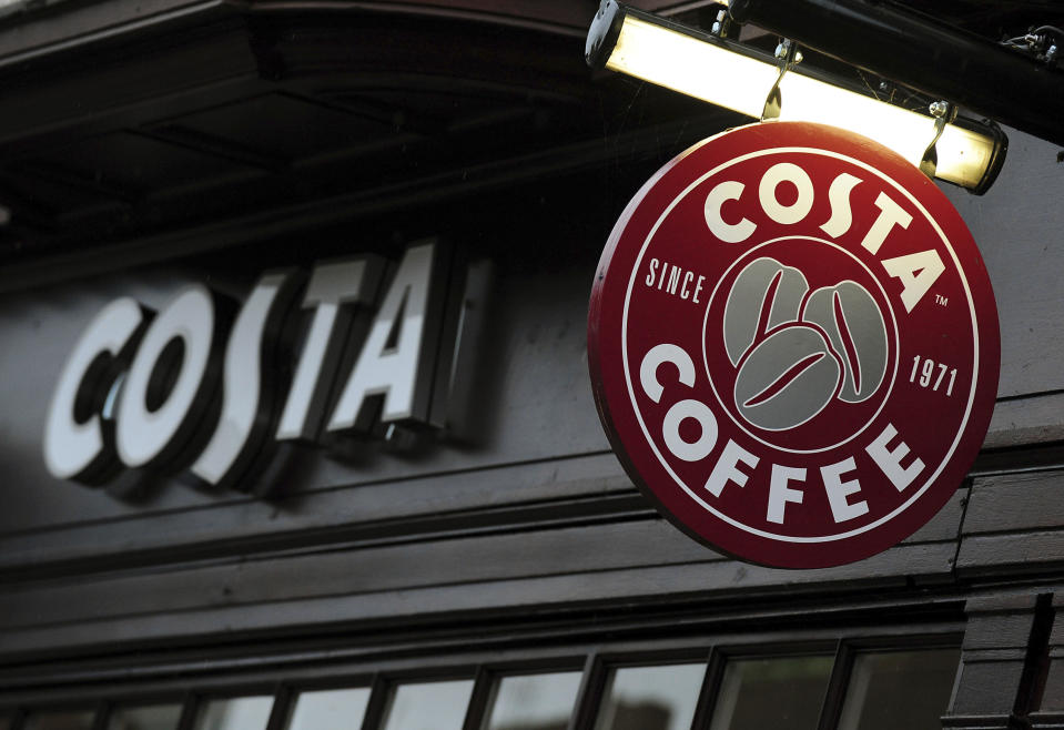 FILE  - In this Nov. 9, 2012 file photo a view of a Costa Coffee shop. Coca-Cola is buying the Costa coffee brand from British firm Whitbread for 3.9 billion pounds ($5.1 billion) in cash, a deal that will see the soft drinks company plug a big hole in its portfolio, it was reported on Friday, Aug. 31, 2018. (Rui Vieira/PA via AP, File)