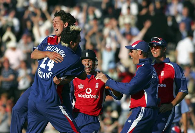 England bowler Jon Lewis is mobbed by team-mates after taking the wicket of Australia's Ricky Ponting in a Twenty20 match at the Rose Bowl Stadium in Southampton 13 June 2005.