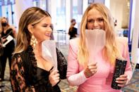 <p>Maren Morris and Miranda Lambert pose with their portable face shields at the 54th Annual CMA Awards at Music City Center in Nashville on Wednesday.</p>