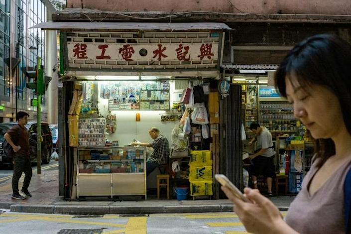 With retail sales down and tourist numbers plunging, Hong Kong's economy appears headed for its first annual contraction since 2009 (AFP Photo/Anthony WALLACE)