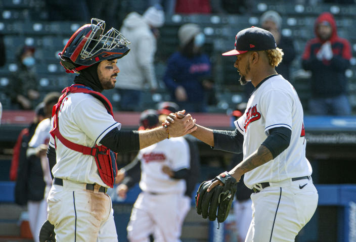 Cleveland Indians' catcher Austin Hedges congratulates closer Emmanuel Clase after the final out against the New York Yankees at a baseball game in Cleveland, Sunday, April 25, 2021. (AP Photo/Phil Long)