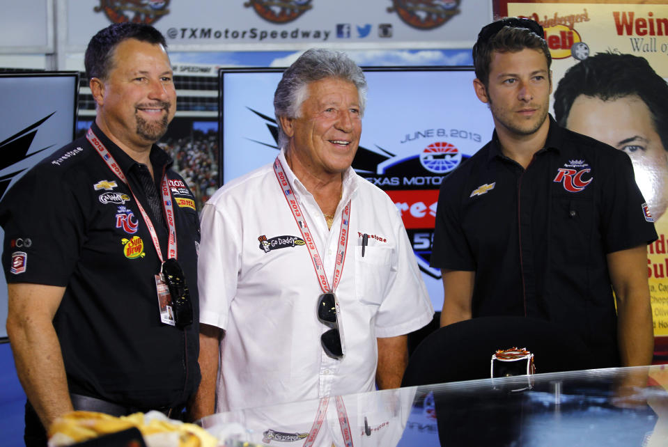 FILE - In this June 7, 2013, photo, Michael Andretti, left, his father, Mario, center, and son, Marco, right, pose for a group photo following a news conference at Texas Motor Speedway in Fort Worth, Texas. Marco Andretti made the decision at the start of this year to step away from full-time racing and essentially end three generations of the most famous family in motorsports competing at the highest level. (AP Photo/Tim Sharp, File)