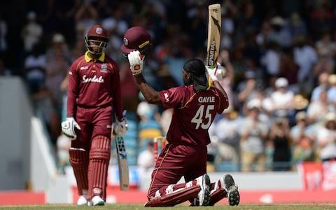 Chris Gayle celebrates hitting a century against England in February - Credit: Popperfoto