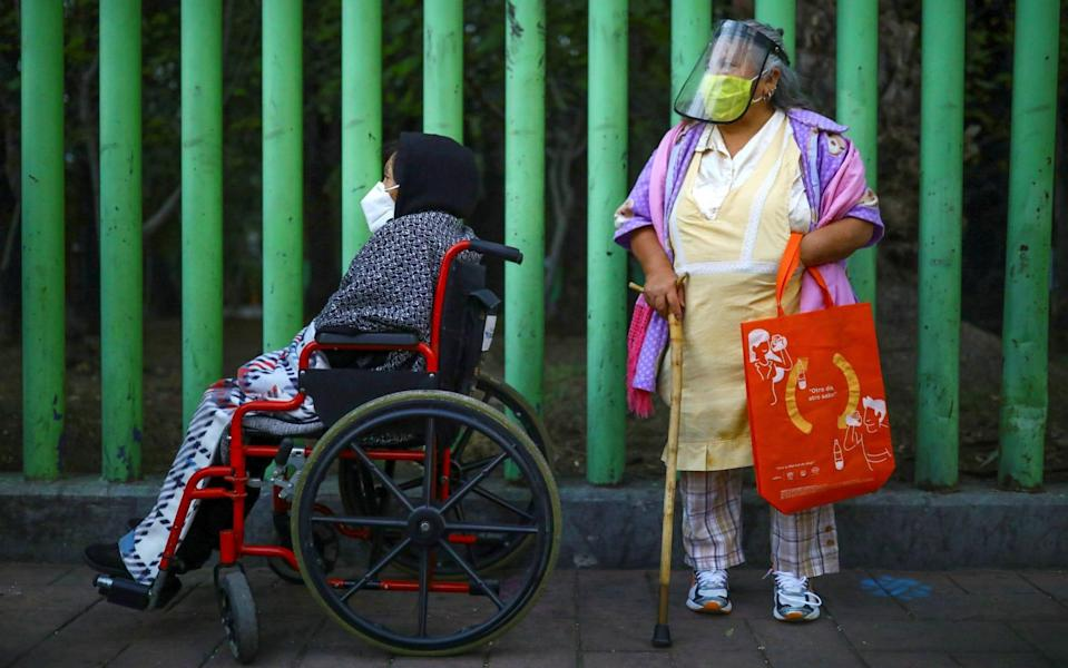 Elderly residents line up during the early morning to receive the Sputnik V vaccine in Xochimilco on the outskirts of Mexico City - REUTERS/Edgard Garrido