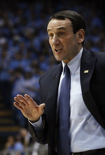 Duke coach Mike Krzyzewski directs his team during the first half of an NCAA college basketball game against North Carolina in Chapel Hill, N.C., Wednesday, Feb. 8, 2012. Duke won 85-84. (AP Photo/Gerry Broome)