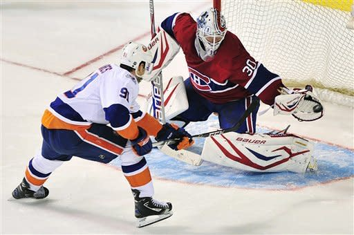 Montreal Canadiens goaltender Peter Budaj makes a save against New York Islanders' John Tavares (91) during the shootout of an NHL hockey game, Saturday, March 17, 2012, in Montreal. The Islanders won 3-2. (AP Photo/The Canadian Press, Graham Hughes)