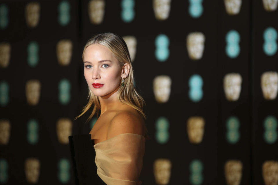 Actress Jennifer Lawrence poses for photographers upon arrival at the BAFTA Awards 2018 in London, Sunday, Feb. 18, 2018. (Photo by Vianney Le Caer/Invision/AP)
