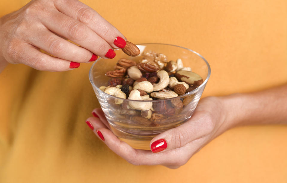 Unsalted nuts are a healthier option. (Posed by model, Getty Images)