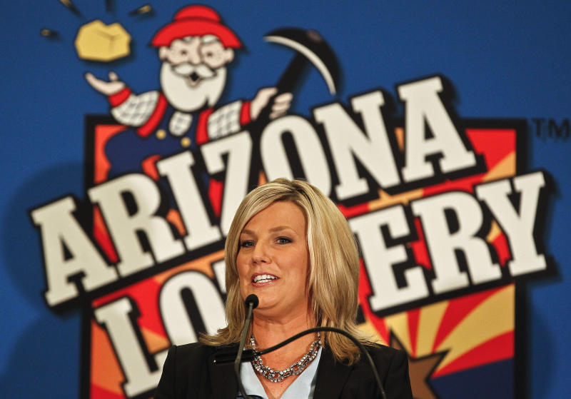 FILE - In this Nov. 29, 2012 photo, Karen Bach, Director of Budget, Products and Communications of the Arizona Lottery, announces during a news conference in Phoenix that one of the winning tickets in the $579.9 million Powerball jackpot was purchased in Fountain Hills, Ariz. The other ticket holders in last week's record $577.5 million Powerball jackpot have claimed their half of the prize but aren't stepping into the spotlight just yet, the Arizona Lottery said Friday, Dec. 7, 2012.  (AP Photo/Ross D. Franklin, File)